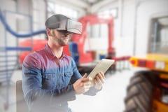 Imagem composta do homem que usa um dispositivo da realidade virtual fotografia de stock royalty free