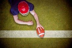 Imagem composta do jogador de futebol americano que marca uma aterrissagem Imagem de Stock