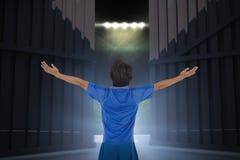 A imagem composta do jogador de futebol que comemora com braços esticou 3d Imagem de Stock Royalty Free