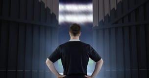 Imagem composta do jogador do rugby com mãos nos quadris 3d Fotografia de Stock