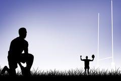 Imagem composta do jogador do rugby pronta para fazer um pontapé de gota Imagem de Stock Royalty Free
