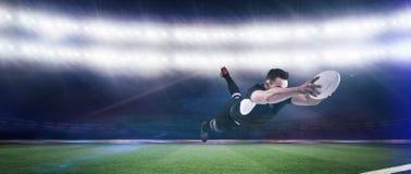 Imagem composta do jogador do rugby que marca uma tentativa imagem de stock royalty free