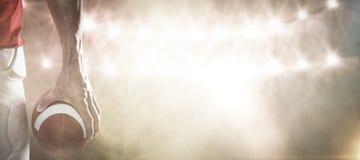 Imagem composta do jogador dos esportes que guarda a bola Foto de Stock