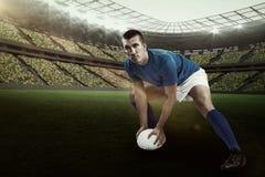Imagem composta do jogador seguro do rugby que joga com 3d Fotografia de Stock