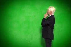 Imagem composta do levantamento maduro pensativo do homem de negócios Imagem de Stock