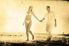 Imagem composta do louro bonito que anda longe do homem que guarda sua mão Imagens de Stock Royalty Free