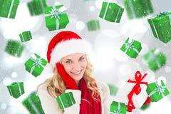 Imagem composta do louro festivo feliz com presente Fotos de Stock Royalty Free