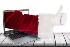 A imagem composta do Natal do pai dá um polegar acima Fotos de Stock