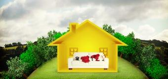 A imagem composta do Natal do pai dorme em um sofá Fotografia de Stock Royalty Free