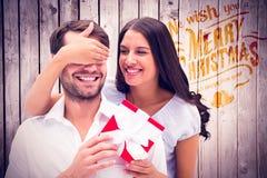 Imagem composta do noivo surpreendente da mulher com presente Imagens de Stock