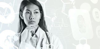 Imagem composta do pensamento asiático focalizado da mulher Fotos de Stock