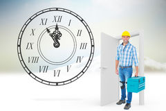 Imagem composta do retrato completo do comprimento do reparador com caixa de ferramentas Imagem de Stock Royalty Free
