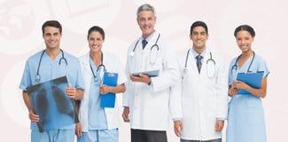 Imagem composta do retrato da equipa médica segura fotos de stock royalty free
