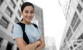 Imagem composta do retrato da mulher de negócios de sorriso que está com os braços cruzados Fotografia de Stock Royalty Free