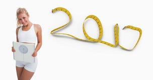 Imagem composta do retrato da mulher feliz nova que guarda escalas de peso Foto de Stock Royalty Free