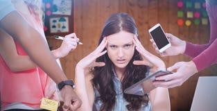 Imagem composta do retrato de mulher de negócios deprimida com cabeça nas mãos imagens de stock royalty free