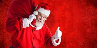 Imagem composta do retrato de Papai Noel que guarda o saco do Natal ao gesticular foto de stock