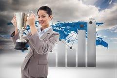 Imagem composta do retrato de uma mulher de negócios que guarda um copo imagens de stock royalty free