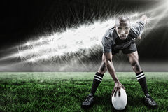 Imagem composta do retrato do desportista que joga o rugby e o 3d Fotografia de Stock Royalty Free