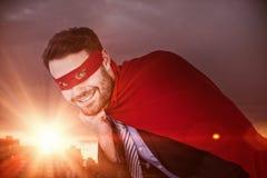 Imagem composta do retrato do homem de negócios de sorriso que finge ser super-herói Imagem de Stock Royalty Free