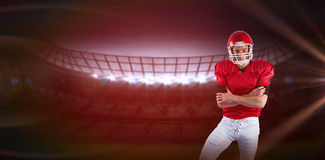 Imagem composta do retrato do jogador de futebol americano sério com os braços cruzados fotos de stock royalty free