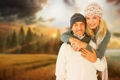 Imagem composta do retrato do marido de abraço da esposa foto de stock