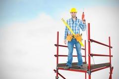 Imagem composta do retrato do reparador de sorriso com ferramentas 3d Imagem de Stock Royalty Free