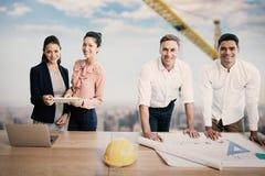 Imagem composta do retrato dos arquitetos na tabela imagem de stock
