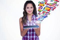 Imagem composta do tablet pc mostrando moreno bonito feliz imagem de stock