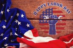 Imagem composta do texto feliz do Dia do Trabalhador sobre ferramentas de terra arrendada colhidas da mão Fotos de Stock Royalty Free