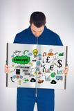Imagem composta do trabalhador manual que mostra um livro Fotografia de Stock