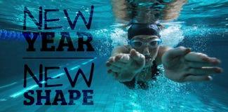 Imagem composta do treinamento atlético do nadador no seus próprios fotografia de stock royalty free