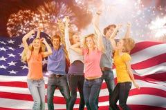 Imagem composta dos amigos que partying junto ao rir e ao sorrir Fotografia de Stock Royalty Free