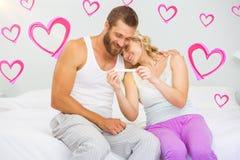 Imagem composta dos corações 3d dos pares e dos Valentim Foto de Stock Royalty Free