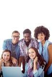 Imagem composta dos estudantes da forma que trabalham em equipe Imagens de Stock