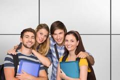 Imagem composta dos estudantes que guardam dobradores no corredor da faculdade imagens de stock royalty free