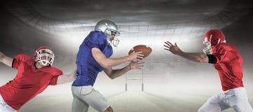 Imagem composta dos jogadores de futebol americano 3D foto de stock royalty free