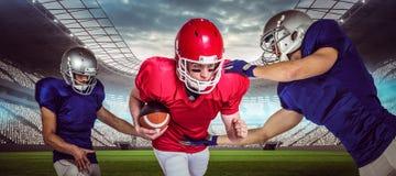 Imagem composta dos jogadores de futebol americano 3D Fotos de Stock Royalty Free