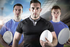 Imagem composta dos jogadores resistentes 3D do rugby fotografia de stock