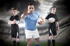 Imagem composta dos jogadores resistentes 3D do rugby fotografia de stock royalty free
