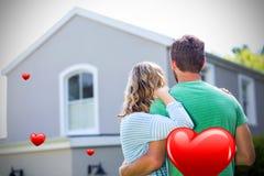 Imagem composta dos pares antes dos corações 3d da casa e dos Valentim Fotos de Stock Royalty Free
