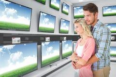 Imagem composta dos pares atrativos que abraçam e que sorriem fotos de stock royalty free