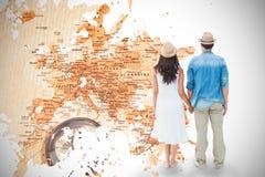 Imagem composta dos pares felizes do moderno que guardam as mãos Fotografia de Stock Royalty Free