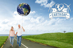 Imagem composta dos pares felizes que andam guardando as mãos Fotografia de Stock Royalty Free