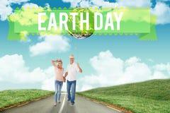 Imagem composta dos pares felizes que andam guardando as mãos Imagem de Stock