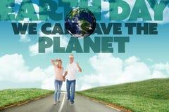 Imagem composta dos pares felizes que andam guardando as mãos Imagem de Stock Royalty Free