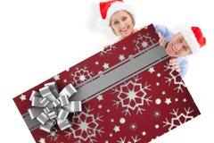 Imagem composta dos pares festivos que mostram o cartaz Foto de Stock Royalty Free