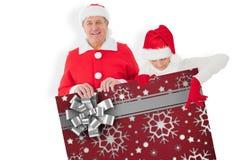 Imagem composta dos pares festivos que mostram o cartaz Fotografia de Stock