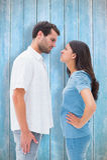 Imagem composta dos pares irritados que olham fixamente em se Foto de Stock Royalty Free