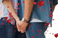 Imagem composta dos pares novos ancas que guardam as mãos Imagem de Stock
